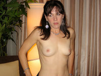Milf posing nude at home