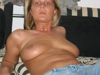 Blond amateur wife posing around house