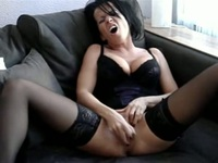 Sweet brunette with a long dildo