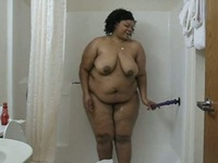 Big black babe taking a shower