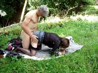 Older dude gets a blowjob in nature