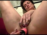 Mommy has a long pink dildo