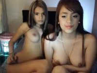 Two cute Asian hotties are naked on cam