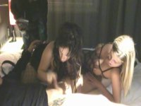 A slut in fishnet is on her side while pleasing