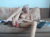 Short haired blonde is masturbating