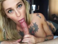 Blonde with tattoos sucks a cock