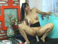 Brunette sits down on a sex toy