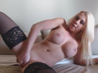 Bimbo blonde plays with her pussy
