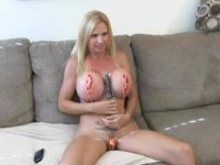 Blonde with fake tits is jacking off