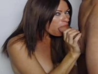 A brunette gets cock in her mouth