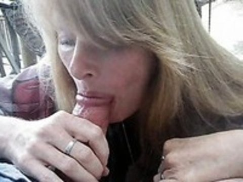 Mature wife blowing a cock