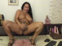 A chick plays with a dildo