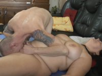 A mature woman is handling a cock
