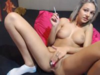 A blonde uses a dildo