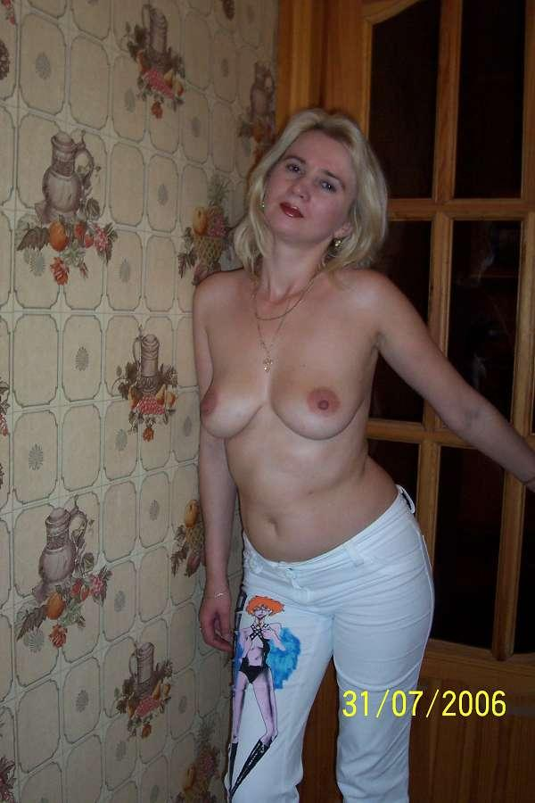 At russian milf home posing