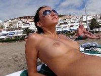 Girlfriend topless on beach