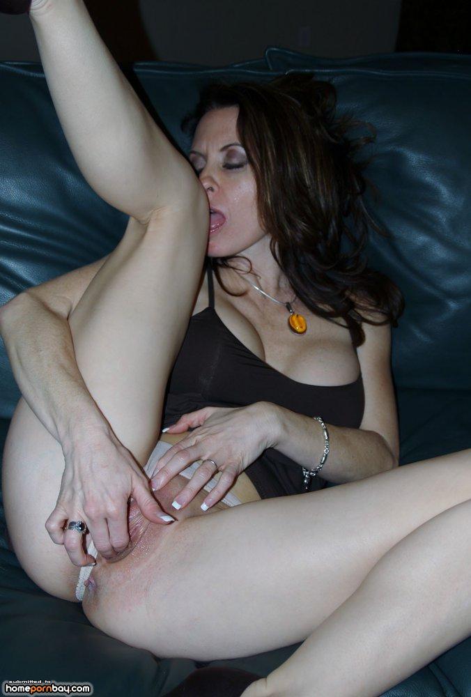 Horny blonde milf fingering herself