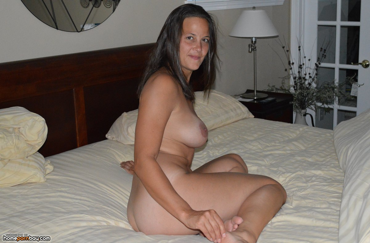 My wife posing naked