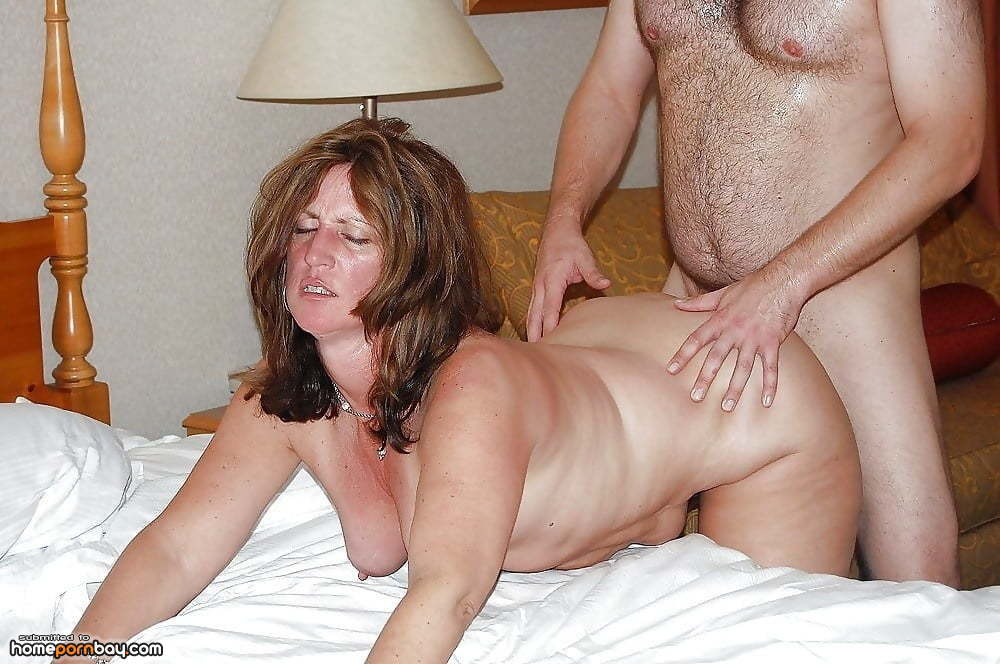 Naked mature redhead wife on the couch
