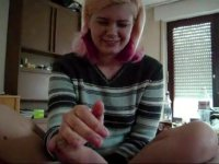 Cute German chick giving a handjob