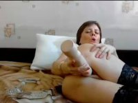 Brunette plays with her sex toys