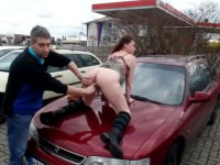 A chick is getting fucked on the car