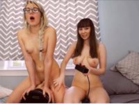 Two lesbians are using sex toys