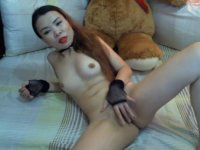 Skinny Asian fingers her pussy