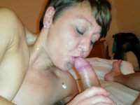 Mature woman sucks a cock