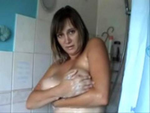 Brit milf soaps up huge tits