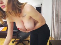 A babe shakes her huge tits