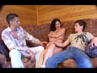 Group sex with a charming brunette in the cottage
