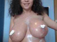 A gorgeous beauty caresses her body and smears it in cream